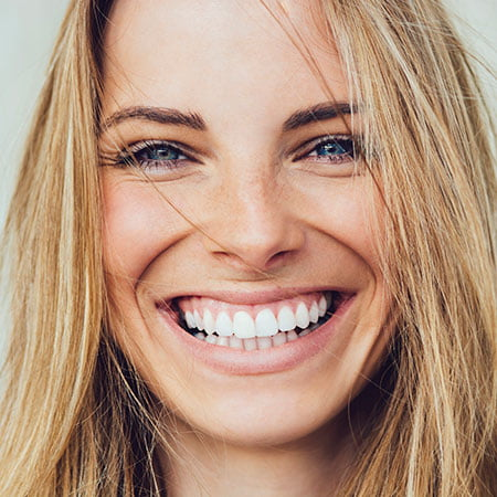 close-up of a blond woman smiling