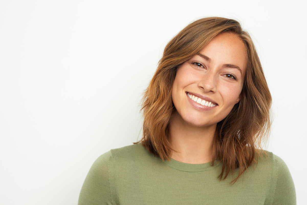 A woman with short hair smiling