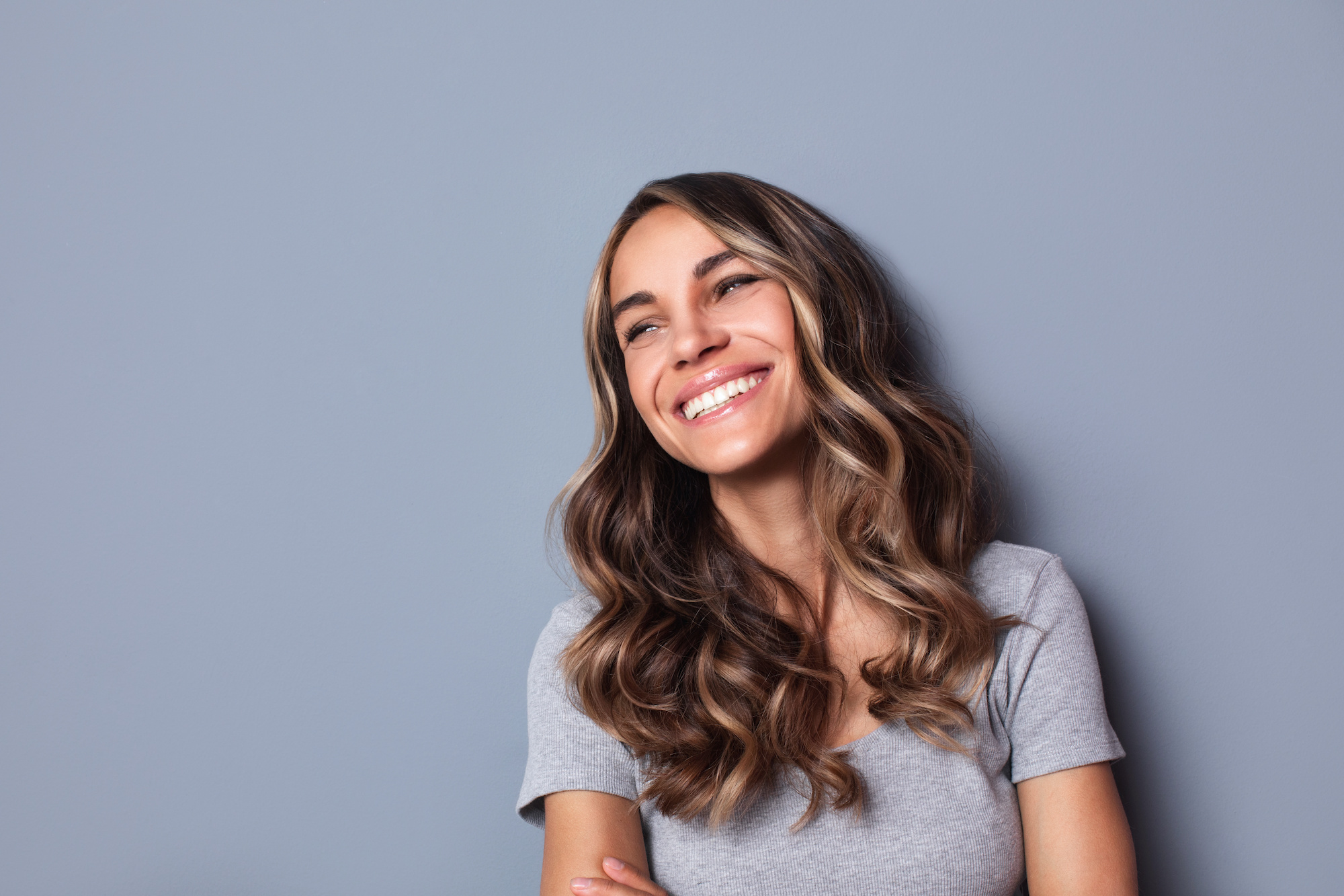 woman smiling to the side