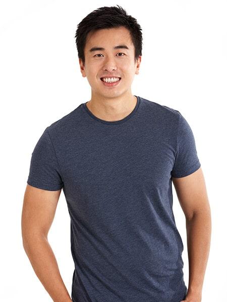 A confident man smiling