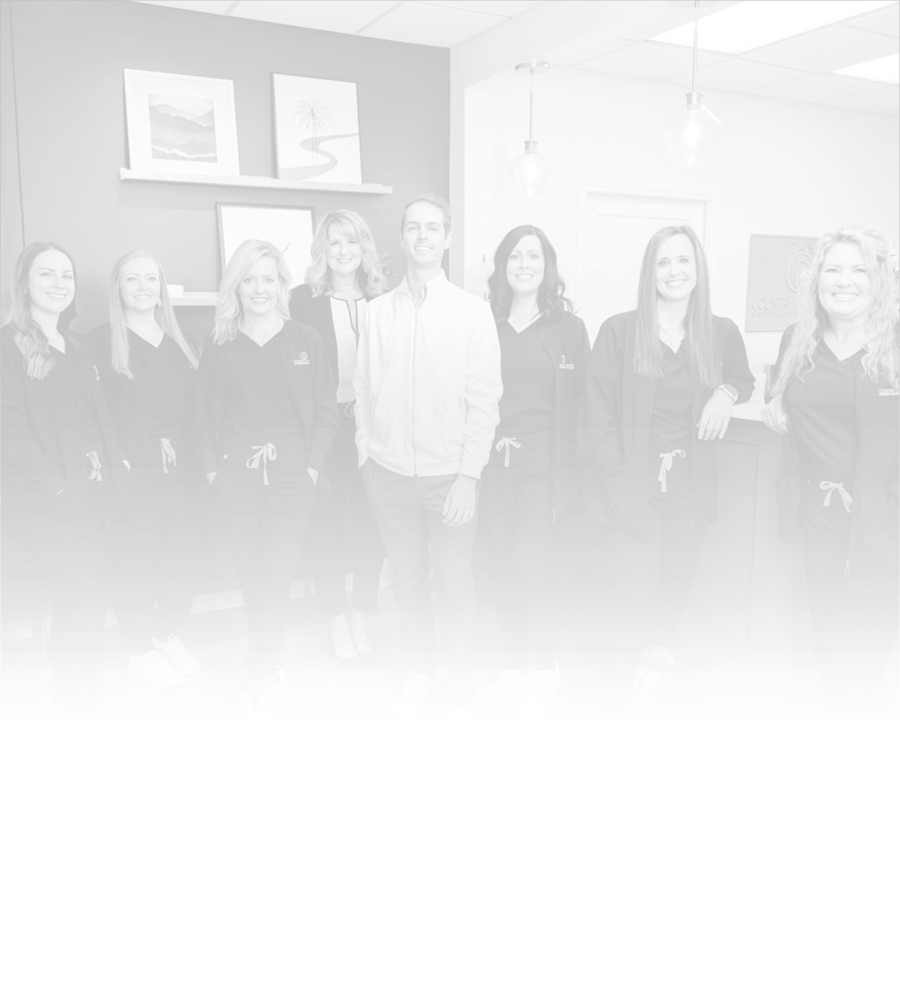 A black and white image of a dental team