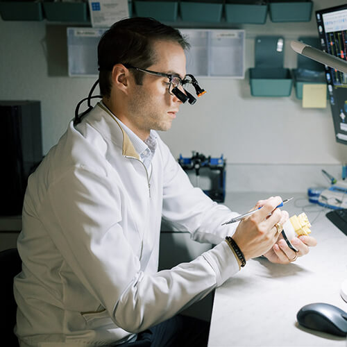 Dr. Ryan Schmidgall working in the dental lab of Fort Worth, TX
