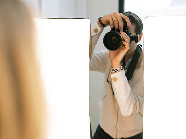 Dr. Schmidgall taking photos for a cosmetic procedure